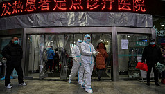 China fortifies virus defences as deaths...