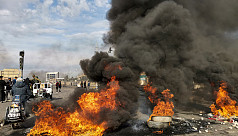 Iraqi security forces raid Baghdad's protest camp, shoot at demonstrators