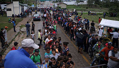 Large migrant caravan prepares to enter...