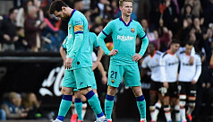 Barca overpowered by Valencia for first...