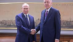 Putin on surprise visit to Assad as...
