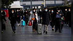 China sees drop in new virus cases,...