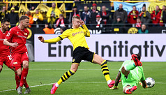 Bayern ease past Mainz to go top, Dortmund's...