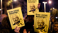 Assange stripped naked and handcuffed, lawyer tells court