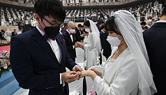 In sickness and in health: Mass wedding defies virus fear