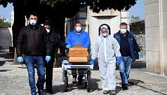 Italy coronavirus death rate slows,...