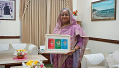 PM receives t-shirts, mugs, and posters for Joy Bangla concert