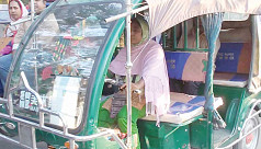 Woman auto-rickshaw driver works hard to get family going