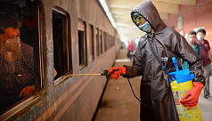 In pictures: Volunteers spray disinfectant at Kamalapur Railway Station
