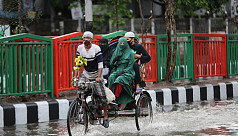 In pictures: Heavy afternoon shower sweeps Dhaka