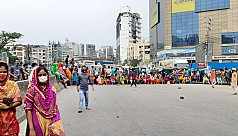 RMG workers block Ring Road in demand for outstanding wages