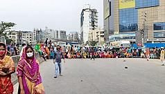 RMG workers block Ring Road in demand...