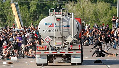 Tanker truck drives into protesters...