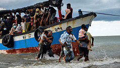 Nearly 100 Rohingya rescued off...