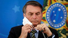 Brazil's Bolsonaro warns virus vaccine can turn people into 'crocodiles'