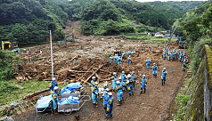 Flood death toll hits 20 as Japan warned of more rainfall