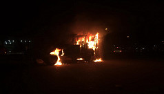 Angry mob torch police tow truck after...