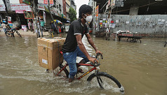 In Pictures: Waterlogging adds to dismay in city life amid pandemic