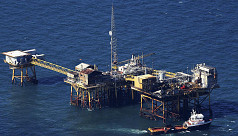 Oil firms evacuate staff, curb offshore...