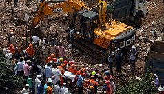 5 dead, scores feared trapped in India building collapse