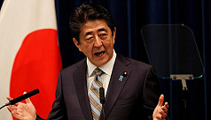 Japan PM Abe enters hospital for...