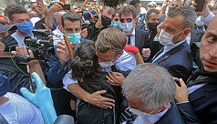 Angry crowds in Beirut urge Macron to...