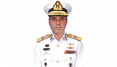 Navy chief adorned with admiral rank...