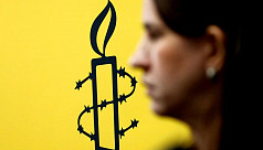 Amnesty suspends India work due to govt...
