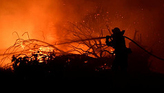 California firefighters race to subdue...