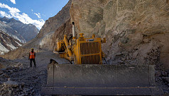 India builds Himalayan bridges, highways...