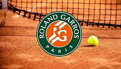 French Open battles gloom as bad weather looms