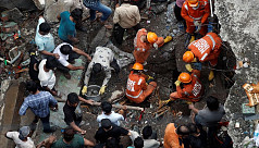 Toll in India building collapse rises...