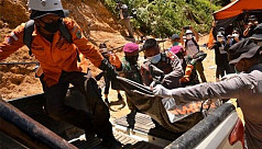Landslide kills 11 miners in...