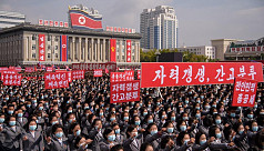 N Koreans rally wearing masks after military parade