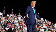 Back on campaign trail, Trump says he...
