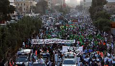 Tens of thousands of Muslims protest...