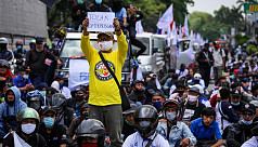 Thousands of Indonesians protest against...