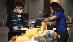 Gloved and masked, US vote counters...