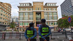 Cambodia begins mass trial of 120 opposition...