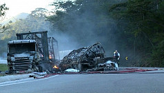 41 killed as bus, truck crash in...