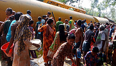 Locals gather to collect oil after oil-laden train derails in Moulvibazar