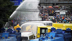 Thai police fire water cannon at parliament...