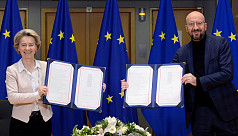 EU leaders sign Brexit deal as UK MPs...