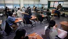 S Korea students sit college exam behind plastic barriers and in hospitals due to Covid-19