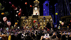 World ushers in New Year in shadow of...