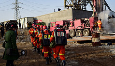 China rescues 11 miners after 14 days...