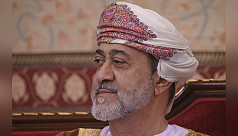Oman sultan issues new law of...