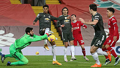 United retain top spot after Liverpool...