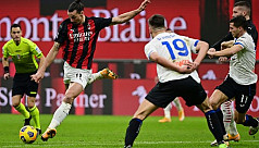 Milan top despite loss, Inter held