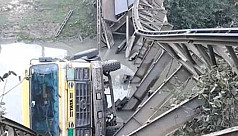 Bailey bridge collapses with truck in...